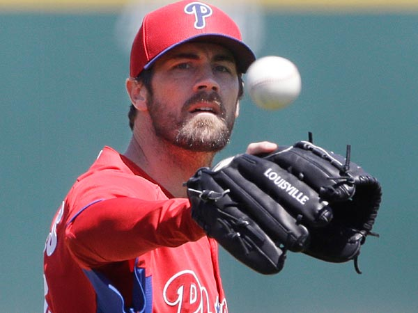 Philadelphia Phillies starting pitcher Cole Hamels prepares to throw during the first inning of an exhibition spring training baseball game against the Detroit Tigers, Wednesday, March 27, 2013 in Lakeland, Fla. (AP Photo/Carlos Osorio)