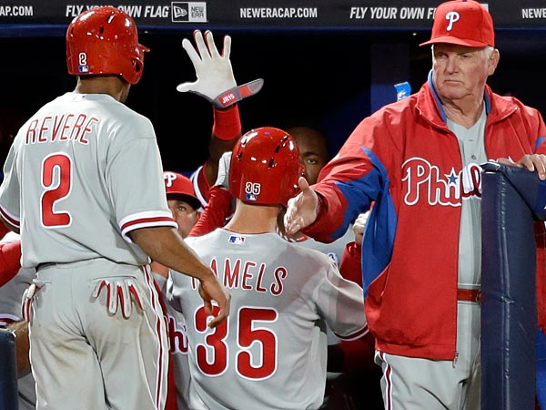 Philadelphia Phillies´ Cole Hamel (35) and Ben Revere (2) are greeted by manager Charlie Manuel, right, after scoring off a single by Chase Utley in the fifth inning. (AP Photo/David Goldman)