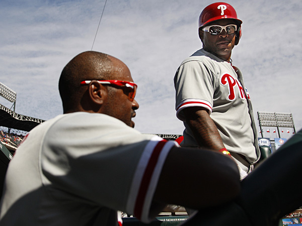 Jimmy Rollins (left) and Marlon Byrd. (Ron Cortes/Staff Photographer)