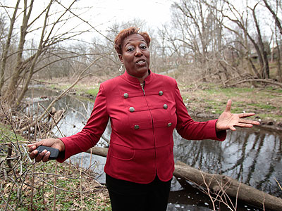 Tracey Gordon on the banks of Cobbs Creek in 2011. (Ed Hille / Staff Photographer)