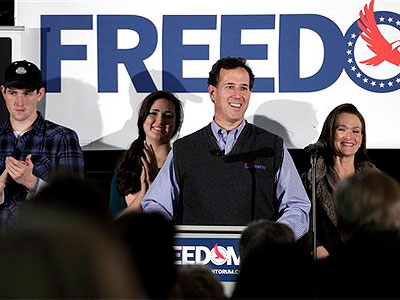 Republican presidential candidate, former Pennsylvania Sen. Rick Santorum, center, addresses supporters as he is joined by son John, left, daughter Sarah Maria and wife Karen, right, at the National Railroad Museum in Green Bay, Wis., Sunday, April 1, 2012. (AP Photo / Jae C. Hong)