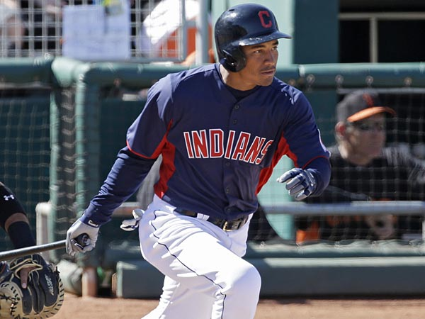 Cleveland Indians´ Ezequiel Carrera bats against the San Francisco Giants in an exhibition spring training baseball game Thursday, March 7, 2013, in Goodyear, Ariz. (AP Photo/Mark Duncan)
