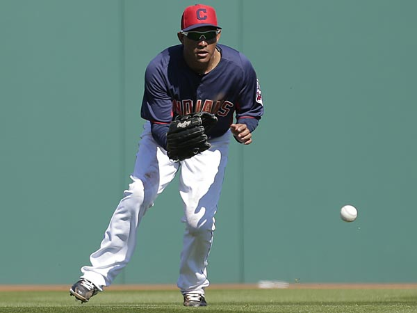 Cleveland Indians left fielder Ezequiel Carrera fields a ball during the second inning of an exhibition spring training baseball game against the San Diego Padres Saturday, March 2, 2013, in Goodyear, Ariz. (AP Photo/Charlie Riedel)
