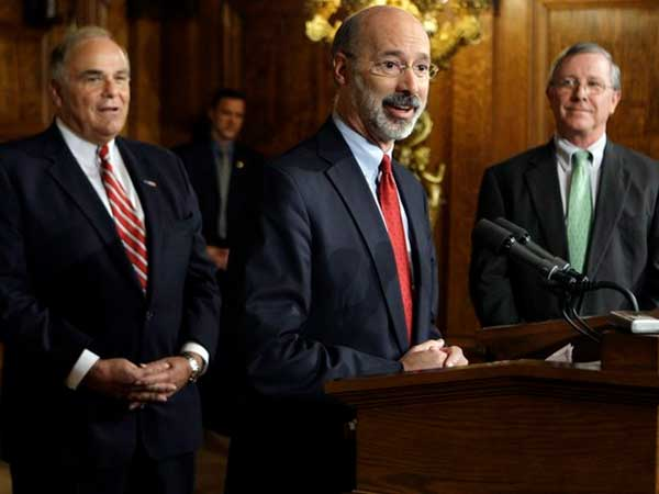 Former Revenue Secretary Tom Wolf announces at a Capitol news conference that he will resign in Nov. 2008. Gov. Rendell (left) said nominated the Pennsylvania Economy League's Stephen Stetler (right) to replace Wolf. (File photo: Carolyn Kaster / Associated Press)