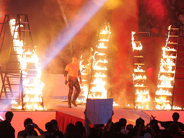 Kane walks between burning ladders before the six-man ladder match during WrestleMania 21 at the Staples Center in Los Angeles on Sunday, April 3, 2005. (Chris Carlson/AP)