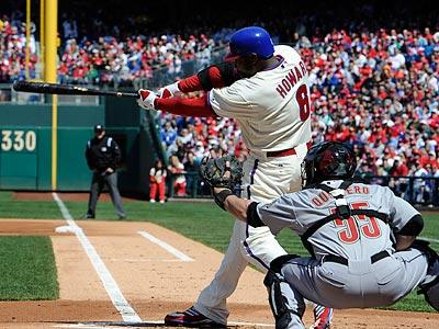 Ryan Howard hits his first home run of the season. (Barbara Johnston/AP)