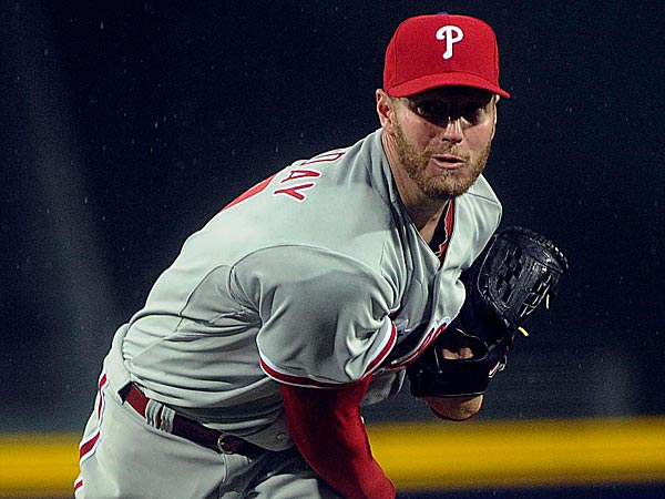 Phillies pitcher Roy Halladay works against the Atlanta Braves during the first inning. (John Amis/AP)