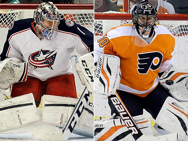Steve Mason and Ilya Bryzgalov. (AP Photos)