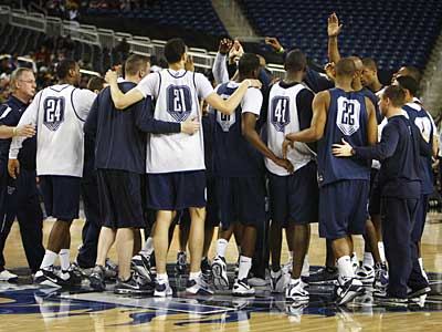 The Wildcats huddle up at the end of Friday´s practice at Ford Field in Detroit. (Eric Mecher / Staff Photographer)