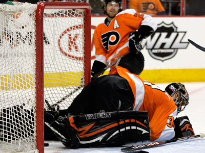 Home ice has not been very friendly to the Flyers this season. (Tom Mihalek/AP)