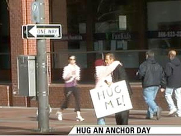 Miek Jerrick gets hugs on Market Street.
