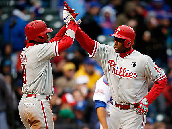 Phillies outfielders John Mayberry Jr., right, and Domonic Brown. (AP Photo/Andrew A. Nelles)