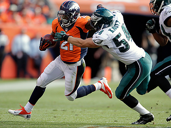 Denver Broncos running back Ronnie Hillman (21) tries to turn up field on Philadelphia Eagles outside linebacker Jake Knott. (AP Photo/Joe Mahoney)