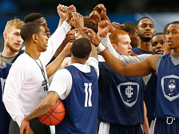 Kevin Ollie (white shirt) gathers his team during a practice before the Final Four. In his second season as coach after taking over for Jim Calhoun, Ollie has the Huskies two wins from a fourth national title. (RON JENKINS / Fort Worth Star-Telegram)