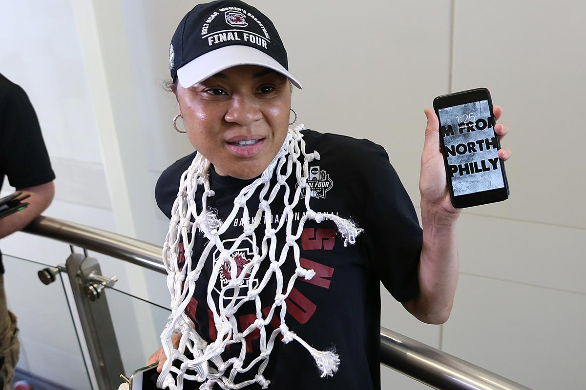 """Dawn Staley holds up her phone showing off her lock screen, which says """"I am from North Philly."""" Dawn Staley and A´ja Wilson spoke to the media after returning from Dallas Texas, where the South Carolina women´s basketball team won the 2017 National Championship."""