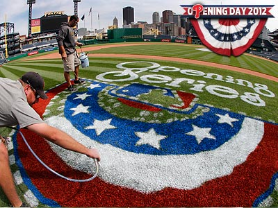 Workers make final preparations for the Opening Day game between the Phillies and Pirates. (Gene J. Puskar/AP)