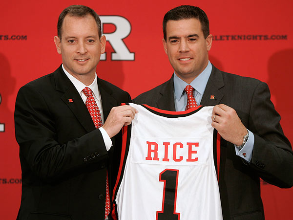 Tim Pernetti (right) is out as Rutgers&acute; athletic director in the wake of the firing of men&acute;s basketball coach Mike Rice (left). (Rich Schultz/AP file photo)<br />