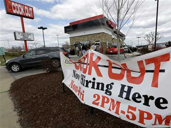 This  Friday, March 29, 2013, file photo, shows a help wanted sign in front of a restaurant in Richmond, Va.  The U.S. economy has enjoyed a four-month stretch of robust job gains, but that appears to be ebbing. (AP Photo/Steve Helber)