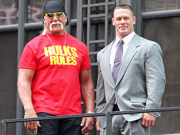 Hulk Hogan, left, and John Cena on top of the The Hard Rock Cafe during a news conference for Wrestlemania 30 on Tuesday, April 1, 2014 in New York. Wrestlemania 30 will be held on Sunday, April 6 in New Orleans . (AP Photo/Starpix, Dave Allocca)