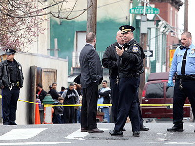 Police officers arrive at the corner of Cambria and Mascher streets Wednesday, where a man had been shot 16 times and survived. (Rachel Gouk / Staff Photographer)