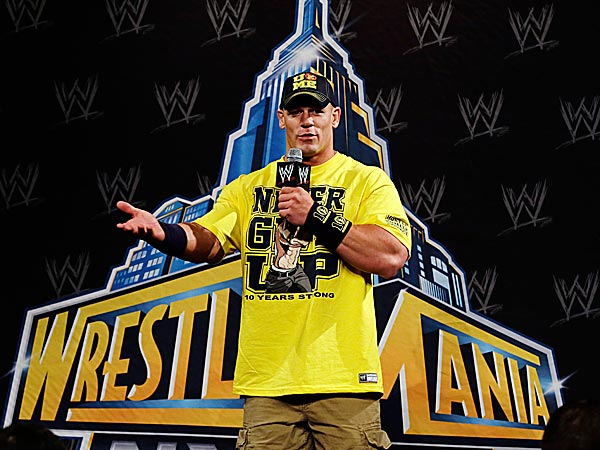 John Cena answers a question during a news conference before the WWE Wrestlemania 29 wrestling event. (Mel Evans/AP)