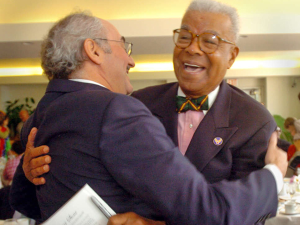 Chuck Stone (right) greets former Daily News editor Zack Stalberg during a reception at the Free Library in 2004. (G.W. MILLER III / FILE PHOTO)