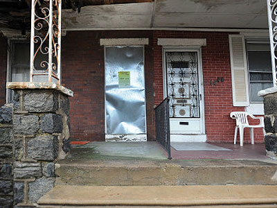 Longtime block captain Carolyn McClary fears this abandoned house on her West Philadelphia street will eventually take the block under. (Sharon Gekoski-Kimmel / Staff Photographer)
