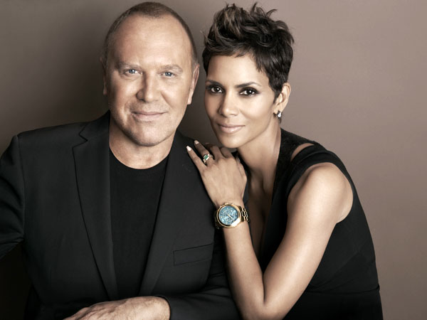 In this April 6, 2013 photo provided by Michael Kors, Kors and actress Halle Berry pose for a photo at Kors´ Midtown office in New York. Kors and Berry have announced a partnership with the U.N. World Food Programme to raise money and awareness to tackle the issue of world hunger. (AP Photo)