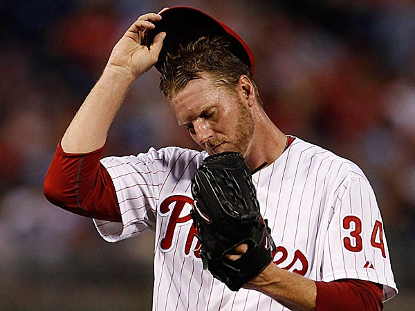 Phillies starter Roy Halladay reacts after allowing a three-run home run in the second inning. (Ron Cortes/Staff Photographer)