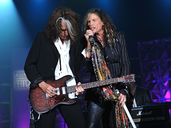NEW YORK, NY - JUNE 13: Steven Tyler and Joe Perry of Aerosmith perform at the Songwriters Hall of Fame 44th Annual Induction and Awards Dinner at the New York Marriott Marquis on June 13, 2013 in New York City. The band announced their North American tour on April 8. (Photo by Larry Busacca/Getty Images for Songwriters Hall Of Fame)