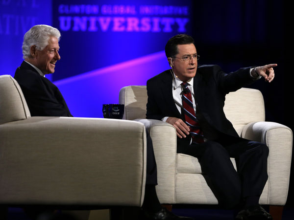 Former President Bill Clinton and Comedy Central´s Stephen Colbert answer questions from the audience during the Clinton Global Initiative at Washington University Saturday, April 6, 2013, in St. Louis. More than 1,000 university students from 75 countries and all 50 states are gathered for a weekend of sessions seeking practical and innovative solutions to the world´s problems. (AP Photo/Jeff Roberson)