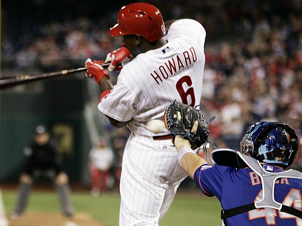 Philadelphia Phillies&acute; Ryan Howard strikes out as New York Mets<br />catcher John Buck gloves the ball during the sixth inning of a<br />baseball game Monday, April 8, 2013, in Philadelphia. The Mets won<br />7-2. (AP Photo/Tom Mihalek)
