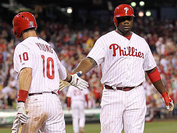 The Phillies´ Ryan Howard celebrates his solo home run with teammate Michael Young. (Yong Kim/Staff Photographer)