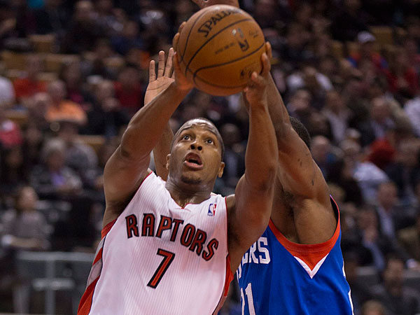Raptors guard Kyle Lowry (7) is fouled on his way to the basket by Philadelphia 76ers forward Thaddeus Young (21) during first half NBA action in Toronto on Wednesday, April 9, 2014. (AP Photo/The Canadian Press, Peter Power)