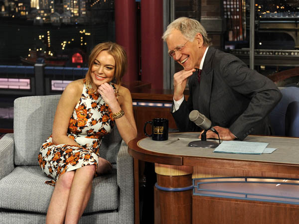 "In this Tuesday, April 9, 2013 photo released by CBS Entertainment, actress Lindsay Lohan talks to David Letterman about her upcoming trip to rehab, her guest star roles in the series ""Anger Management"" and film ""Scary Movie 5"" and more during the ""Late Show with David Letterman,"" (11:35 PM-12:37 AM, ET/PT) on the CBS Television Network, in New York. (AP Photo/CBS Entertainment, Jeffrey R. Staab)"