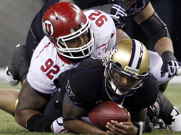 Washington´s Keith Price is brought down by Utah´s Star Lotulelei on a quarterback keeper in the second half of NCAA college football game Saturday, Nov. 10, 2012, in Seattle. Washington won 34-15. (AP Photo/Elaine Thompson)