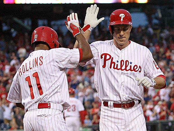 The Phillies´ Chase Utley celebrates with Jimmy Rollins after his home run in the first inning. (David M Warren/Staff Photographer)