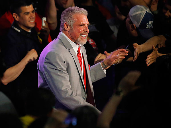 James Hellwig, better known as The Ultimate Warrior, makes his way to the ring during WWE Monday Night Raw at the Smoothie King Center in New Orleans. (AP Photo/NOLA.com, David Grunfeld)
