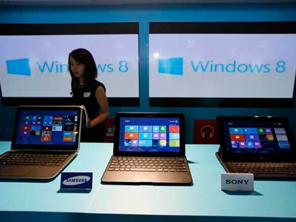 Orders for new computers fell nearly 20 percent in July. (AP Photo/Kin Cheung, File)