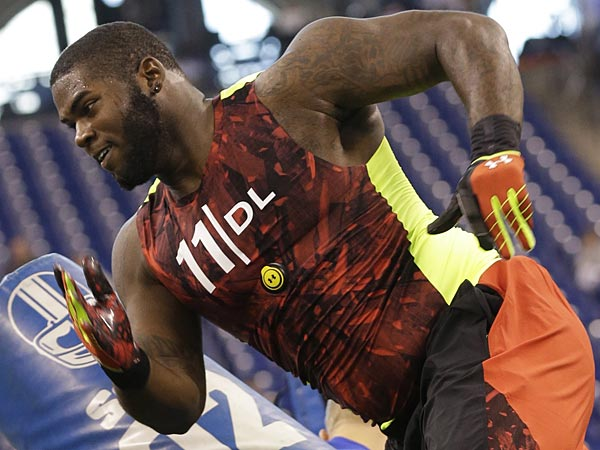 Florida defensive lineman Sharrif Floyd runs a drill during the NFL football scouting combine in Indianapolis, Monday, Feb. 25, 2013. (AP Photo/Dave Martin)<br />