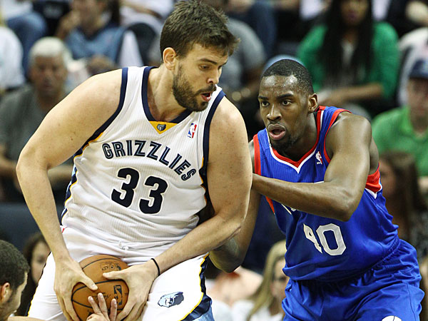 Michael Carter-Williams, left, tries to steal the ball from Memphis Grizzlies center Marc Gasol (33) who drives against 76ers forward Jarvis Varnado (40) in the first half of an NBA basketball game on Friday, April 11, 2014, in Memphis, Tenn. (Mike Brown/AP)