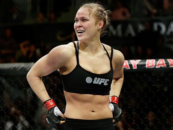 Ronda Rousey looks around after defeating Sara McMann in a UFC 170 mixed martial arts women´s bantamweight title bout in Las Vegas. (Isaac Brekken/AP)