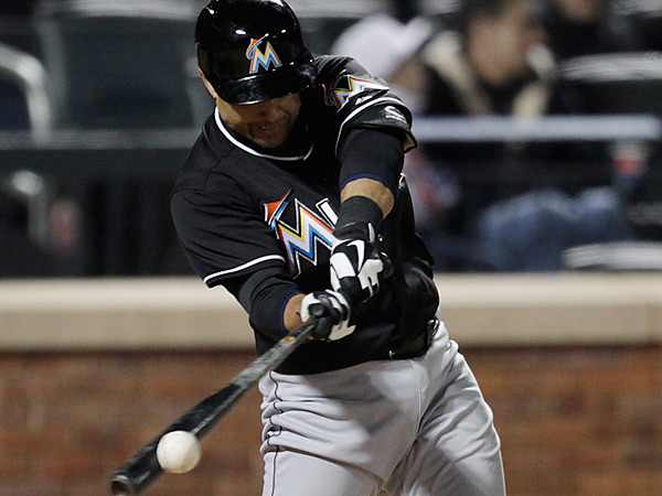 Miami Marlins Placido Polanco singles in two runners in the seventh inning against the New York Mets in a baseball game at Citi Field, Friday, April 5, 2013 in New York. (AP Photo/Mark Lennihan)