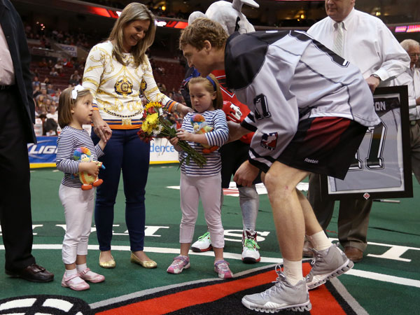 Wings captain Brodie Merrill greets Stevie and Clementine Sanderson -- daughters of the late former Wing Chris Sanderson -- prior to Sunday´s game at the Wells Fargo Center. (Philadelphia Wings photo)