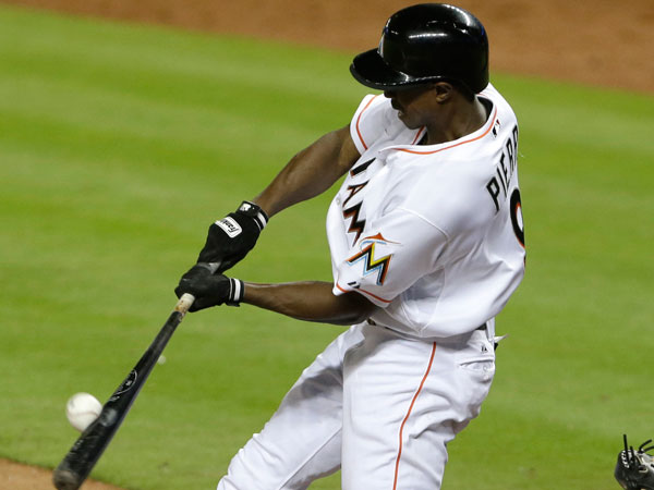 Juan Pierre fouls out during the eighth inning of a baseball game against the Atlanta Braves, Wednesday, April 10, 2013 in Miami. The Braves defeated the Marlins 8-0. (Wilfredo Lee/AP)