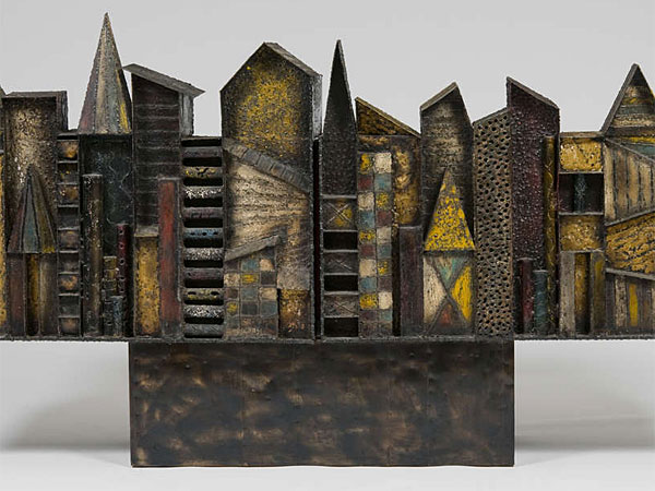 "Evans´ ""Skyline Cabinet"" (c. 1966), of welded and patined steel, brass, and pigments, demonstrates his ability to transform a functional object into sculpture."