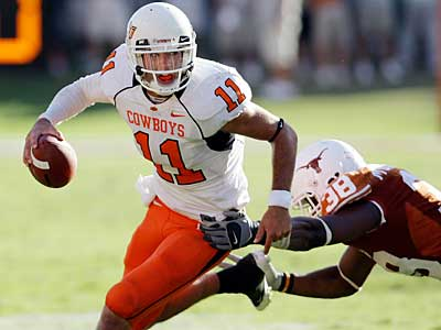 The Eagles hosted Oklahoma State QB Zac Robinson, according to a report. (Eric Gay / AP Photo)