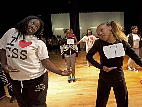 At the Boys and Girls Club of Camden, the Sophisticated Sisters dance and drill troupe hold auditions for new members on 4/13/13.  Here, member Germaine Trusty, 15, left; teaches Nyjai Grant, 11, the routine for the audition.  ( APRIL SAUL / Staff )