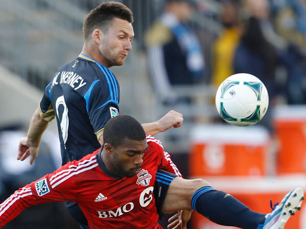 Toronto&acute;s Ashtone Morgan grabs the Union&acute;s Jack McInerney as he tries to<br />kick the ball on Saturday, April 13, 2013 at PPL Park. (Ron Cortes/Staff Photographer)