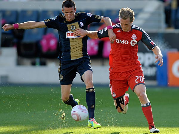 Philadelphia Union´s Sebastien Le Toux (9) drives past Toronto FC´s Ty Harden (20) during the first half of an MLS soccer match, Saturday, Oct. 15, 2011, in Chester, Pa. (AP Photo/Michael Perez)